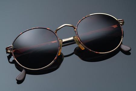 sunglasses with round frame on dark background