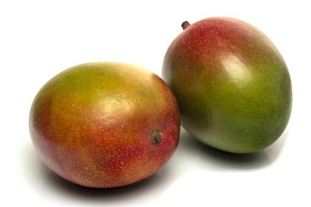 two mango fruit isolated on white background