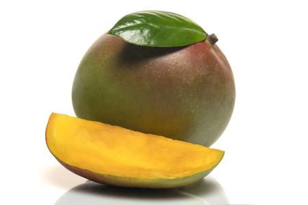 mango fruit with green leaf and cut mango slice isolated on white background