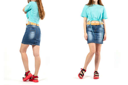 a girl in a denim short skirt and sports summer shoes in red on a white background