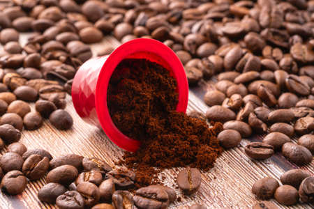 coffee capsules with ground coffee and coffee beans, coffee background