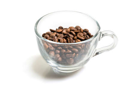 roasted coffee beans in a glass cup isolated on a white background Imagens