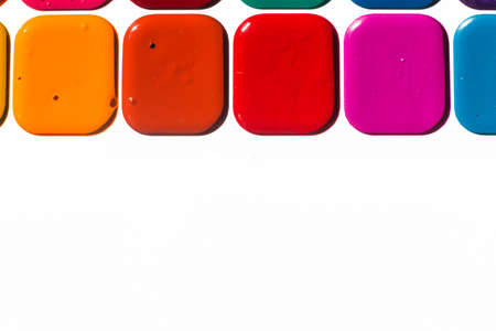 Multi-colored bright Watercolor paints close up. A frame from paints on a white background Banco de Imagens - 150647244