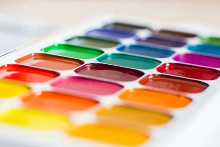 Multi-colored bright Watercolor paints on a table close up. Reklamní fotografie