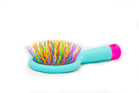 Bright children's Massage hairbrush on a white background it is isolated