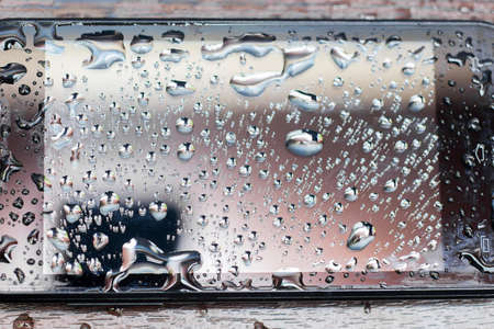 Texture wet phone. Drops in vepmnl the smartphone