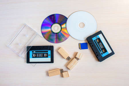Old recorder cartridge, USB stick, and compact disks