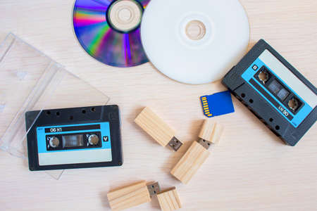 Old recorder cartridge, USB stick, and compact disks together.
