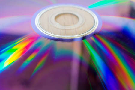 Compact disk close up. Scratches on the magnetic party of a disk. Reklamní fotografie