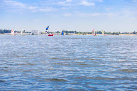 Sailing regatta is on the Volga River near the city of Volgograd. Many yachts with sails on the water Banque d'images