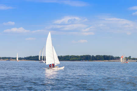Competition among yachts with sails on the water of the Volga River