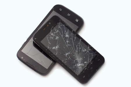Two broken black smartphones lie the friend 免版税图像