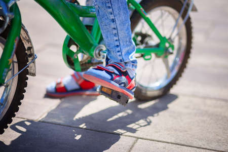Bicycle pedal close up. The child is pedaling. Healthy lifestyle concept