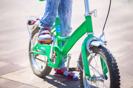 Bicycle pedal close up. The child is pedaling. Kids sports