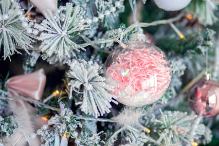 Christmas tree decoration close-up. Christmas tree decor elements in gentle trendy colors. Background for postcards
