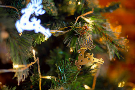 Christmas decoration in the form of a galloping deer on a Christmas tree.