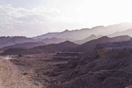 dahab: Rider on the camel in Mountains at Sinai Peninsula, Dahab, Egypt Stock Photo