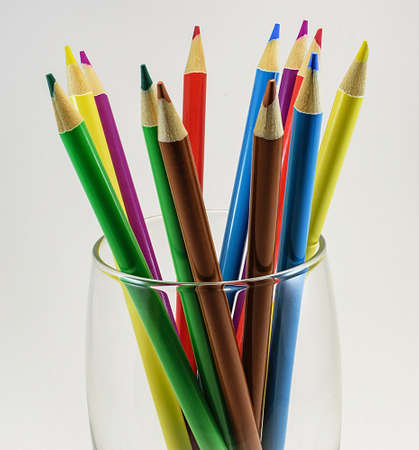 Colored pencils in a transparent glass