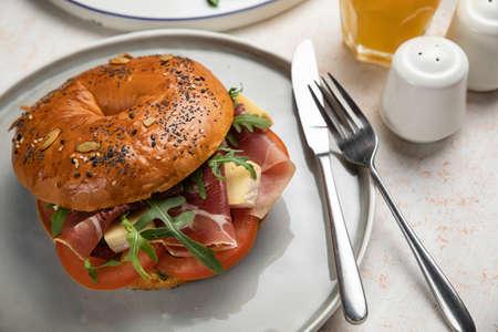 Burger sandwich with prosciutto, cream cheese