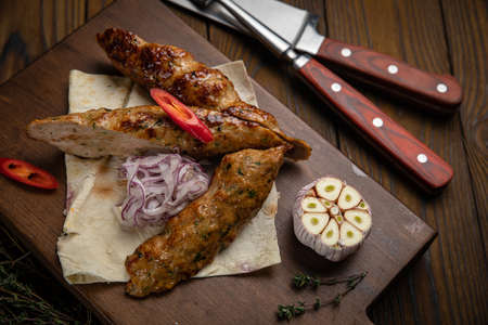 meat on pita bread with garlic on a wooden background Foto de archivo