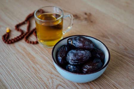 Elegant and Beautiful settings for ramadan holidays in islamic culture Ramadan also known as Ramzan Ramadhan Ramathan with herb tea and Prayer beads.