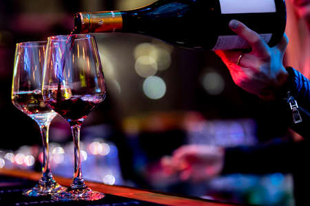 POURING WINE at bars resturant and weddings. also other social events. Stock fotó