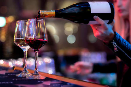 POURING WINE at bars resturant and weddings. also other social events. Stok Fotoğraf