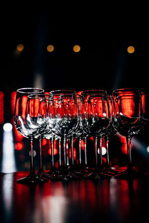 Luxury table settings for fine dining with and glassware, beautiful blurred  background. For events, weddings.  Preparation for holiday  Christmas and Hanukkah dinner night. props for weddings, birthdays, and celebrations. Stock fotó
