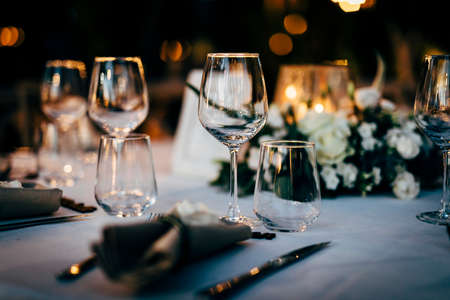 Luxury table settings for fine dining with and glassware, beautiful blurred background. For events, weddings. Preparation for holiday Christmas and Hanukkah dinner night. props for weddings, birthdays, and celebrations.