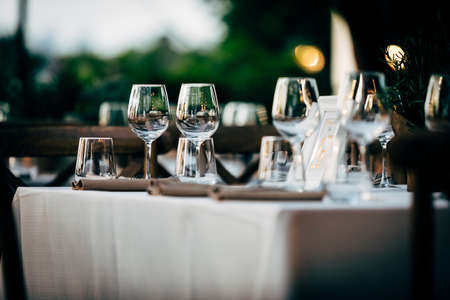 Luxury table settings for fine dining with and glassware, beautiful blurred background. For events, weddings. Preparation for holiday Christmas and Hanukkah dinner night. props for weddings, birthdays, and celebrations. Reklamní fotografie