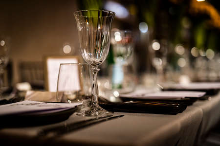 Luxury table settings for fine dining with and glassware, beautiful blurred  background. For events, weddings.  props for weddings, birthdays, and celebration. Wedding, restaurant,