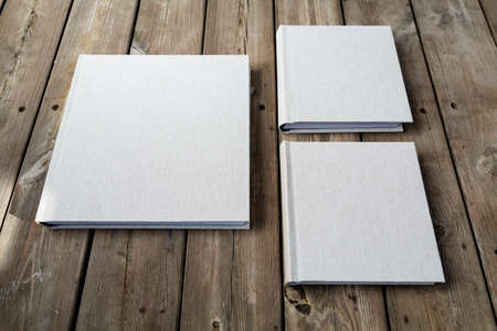 Wedding albums on beautiful wood background. Cloth cover without names. Can be used as design element. Set of albums. wedding, albums, books, 스톡 콘텐츠