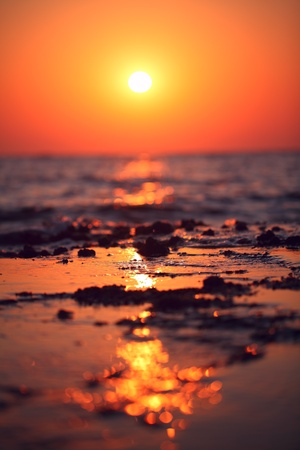 Sun just started coming up. Only one moment showing to us the treasure hidden deep at sea. This gold waiting for you long time. Who knows?   版權商用圖片