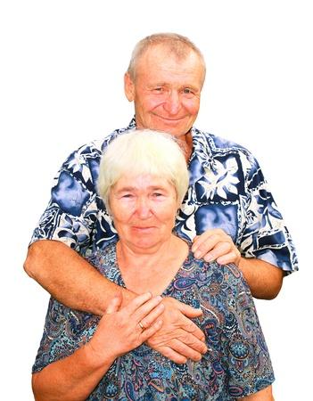 Smiling senior couple embracing izolated