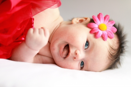 Smiling baby girl with big blue eyes close up photo