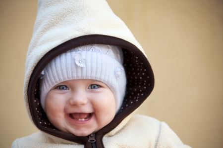 laughing cute baby girl  outside looking at camera close up Standard-Bild