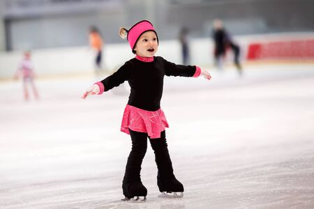 Beautiful girl learns to skate