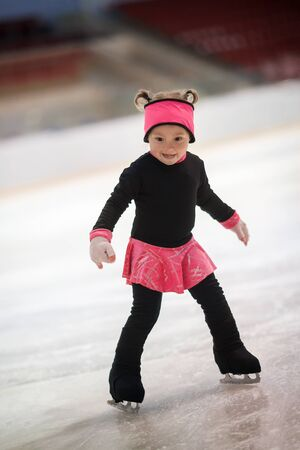 funny little girl is skating