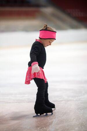 Little girl learns to skate