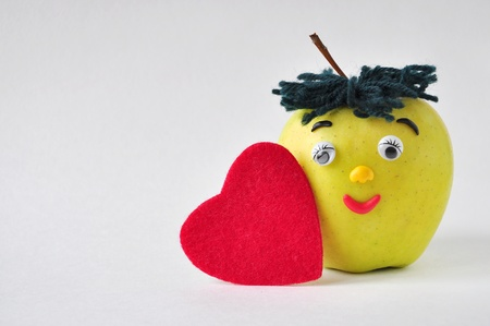funny green apple and red heart photo