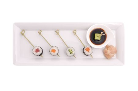 brigt: Sushi on stick  in plate with sause. Stock Photo