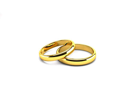two gold wedding rings isolated on white background photo