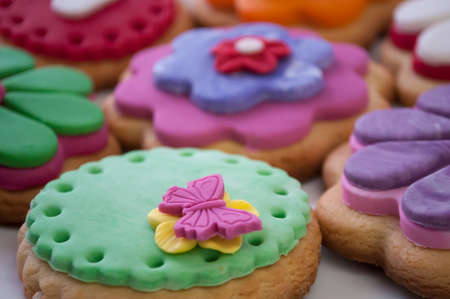 cookies with colorful flowers from mastic closeup photo
