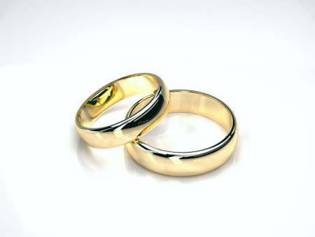 gold rings: two gold wedding rings isolated on white background. yellow and white gold