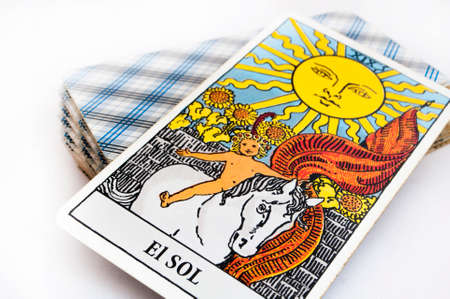 the deck of Tarot cards on white background, top down card sun Foto de archivo