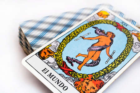 the deck of Tarot cards on white background, top down card the world