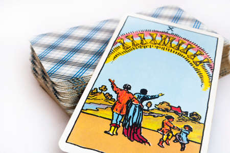 the deck of Tarot cards on white background, top down card ten of cups