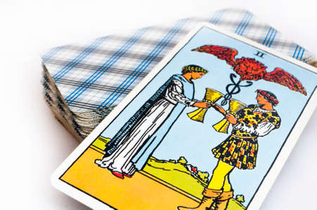 the deck of Tarot cards on white background, top down card tow of cups Foto de archivo