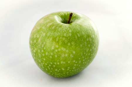 mouthwatering: bright colorful mouthwatering green Apple on white background closeup