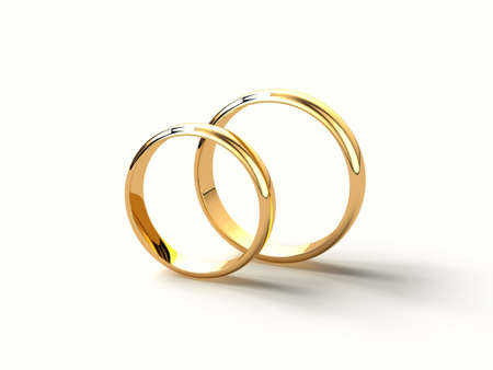 chrome man: two gold wedding rings isolated on white background